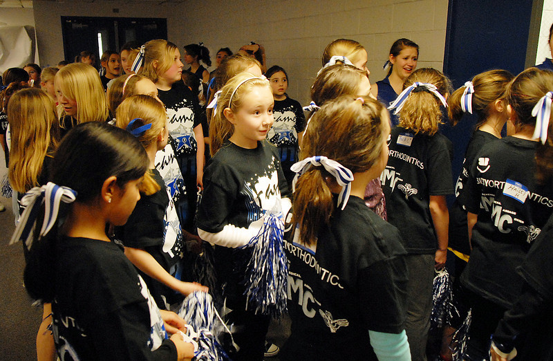 Girls in the Lil' Poms clinic wait in a room before they perfom at halftime at Broomfield High on Friday. <br /> February 10, 2011<br /> staff photo/David R. Jennings