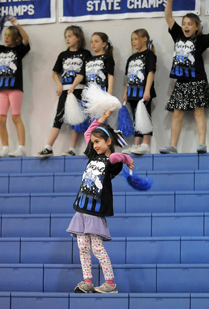 Anna Rehak, 7, dances in the stands while watching fellow participants perform at the Lil' Poms clinic a fundraiser for the Broomfield High pom squad on Friday. <br /> February 10, 2011<br /> staff photo/David R. Jennings
