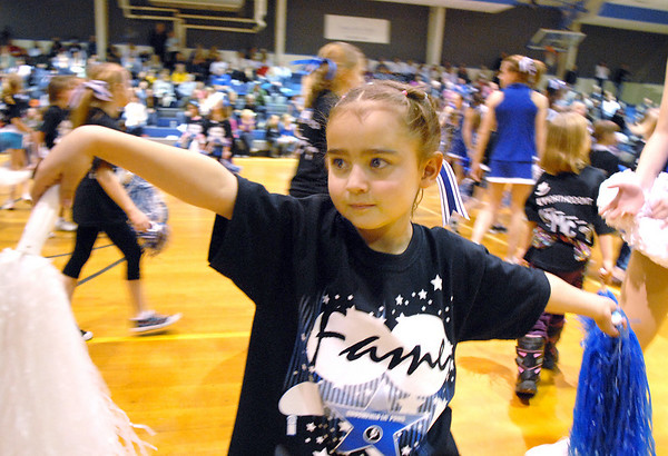 Payton Deleir, 6, holds her pose after the performace of the Lil' Poms at halftime of the Broomfield girls basketball game in the Wilkerson gym on Friday. <br /> February 10, 2011<br /> staff photo/David R. Jennings