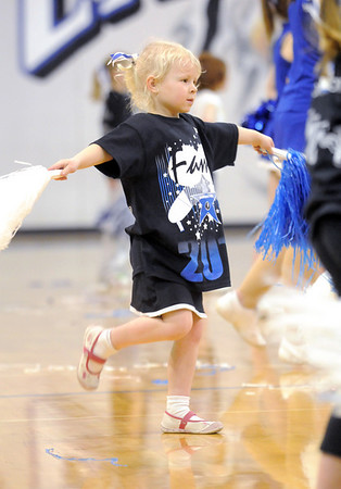 Lidia Baker, 5, dances to Fame while rehearsing for the half time performance on Friday during the Lil' Poms clinic, a fundraiser for the Broomfield High pom squad. <br /> February 10, 2011<br /> staff photo/David R. Jennings