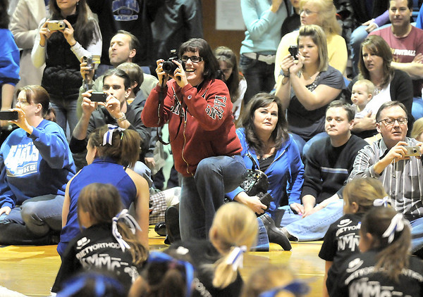 Parents take pictures of their children during the  Lil' Poms performance at halftime clinic at Broomfield High on Friday. <br /> February 10, 2011<br /> staff photo/David R. Jennings