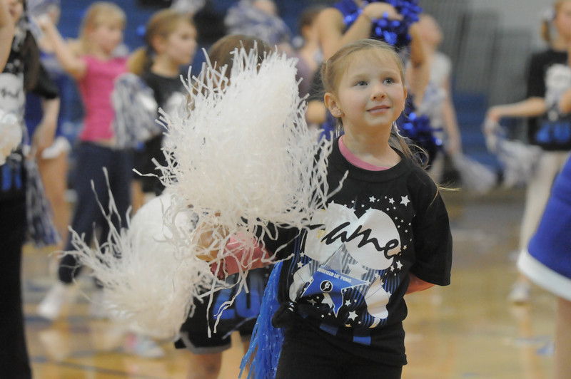 Allison Kirkpatrick, 5 3/4, dances with the Lil' Poms at Halftime of the Broomfield girls basketball game in the Wilkerson gym on Friday. <br /> February 10, 2011<br /> staff photo/David R. Jennings