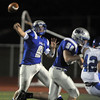 Broomfield's quarterback Angelo Perez passes on the run against Longmont during Friday's game at Elizabeth Kennedy Stadium.<br /> October 21, 2011<br /> staff photo/ David R. Jennings