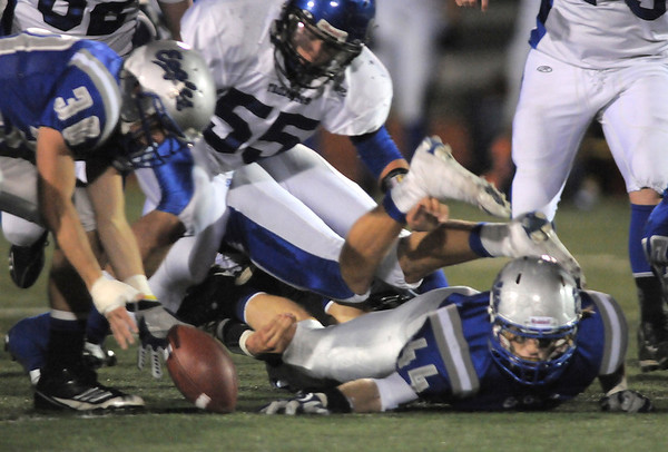 Broomfield's Lee Cannon recovers Longmont's fumble during Friday's game at Elizabeth Kennedy Stadium.<br /> October 21, 2011<br /> staff photo/ David R. Jennings