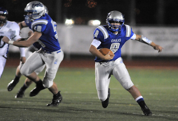 Broomfield's quarterback Angelo Perez runs the ball downfield against Longmont during Friday's game at Elizabeth Kennedy Stadium.<br /> October 21, 2011<br /> staff photo/ David R. Jennings