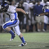 Longmont's DJ Fowler avoids a tackle by Broomfield's Sean Robnett during Friday's game at Elizabeth Kennedy Stadium.<br /> October 21, 2011<br /> staff photo/ David R. Jennings