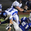 Broomfield's Tyler Stuemky sacks Longmont's quarterback Forest Wetterstrom during Friday's game at Elizabeth Kennedy Stadium.<br /> October 21, 2011<br /> staff photo/ David R. Jennings