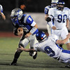Broomfield's Angelo Perez runs the ball as Longmont's Ian Pomper reaches for the tackle during Friday's game at Elizabeth Kennedy Stadium.<br /> October 21, 2011<br /> staff photo/ David R. Jennings
