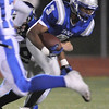 Broomfield's Sean Robnett runs for extra yards while being tackled by Longmont during Friday's game at Elizabeth Kennedy Stadium.<br /> October 21, 2011<br /> staff photo/ David R. Jennings
