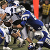Broomfield's Andrew McLean and Dan Perse sack  Longmont's quarterback Forrest Wetterstrom causing a fumble during Friday's game at Elizabeth Kennedy Stadium.<br /> October 21, 2011<br /> staff photo/ David R. Jennings