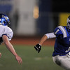 Broomfield's Harrison Einspar runs downfield against Longmont's Ian Pomper during Friday's game at Elizabeth Kennedy Stadium.<br /> October 21, 2011<br /> staff photo/ David R. Jennings