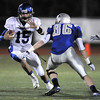 Longmont's quarterback Forrest Wetterstrom runs downfield against Broomfield's Dan Perse during Friday's game at Elizabeth Kennedy Stadium.<br /> October 21, 2011<br /> staff photo/ David R. Jennings