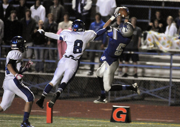 Broomfield's Nick Ongarato catches the ball in the endzone past Longmont's Drew Magee to score during Friday's game at Elizabeth Kennedy Stadium.<br /> October 21, 2011<br /> staff photo/ David R. Jennings