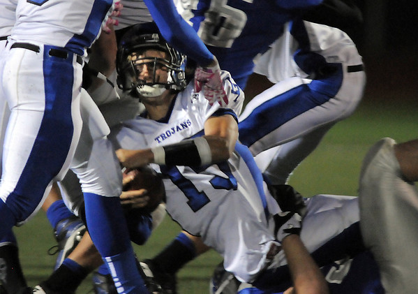 Longmont's quarterback Forrest Wetterstrom is tackled by Broomfield during Friday's game at Elizabeth Kennedy Stadium.<br /> October 21, 2011<br /> staff photo/ David R. Jennings