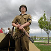 "Jarred Schroeder, 15, with ""Crew 42"" re-enactment group and Boy Scout Troop 49 out of Lafayette, looks at the clouds forming as he stands guard next to tents during the Broomfield Veterans Memorial Museum Memorial Day Picnic at the Broomfield County Commons Park on Monday.<br /> May 30, 2011<br /> staff photo/David R. Jennings"