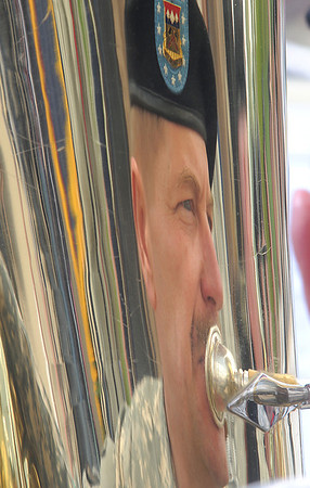 Tom Seidl's reflection is seen in his tuba while playing for the Colorado National Guard 101st Army Band during the Broomfield Veterans Memorial Museum Memorial Day Picnic at the Broomfield County Commons Park on Monday.<br /> May 30, 2011<br /> staff photo/David R. Jennings