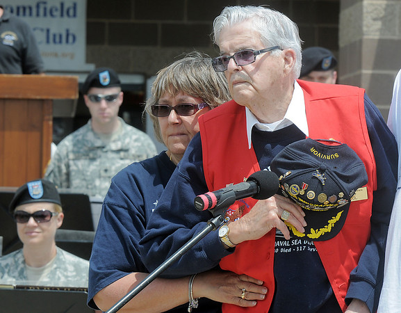 World War II veteran Paul Murphy with his step daughter Tammy Brown, stands at the Broomfield Police Honor Guard marches away after posting the colors during the Broomfield Veterans Memorial Museum Memorial Day Picnic at the Broomfield County Commons Park on Monday.<br /> May 30, 2011<br /> staff photo/David R. Jennings