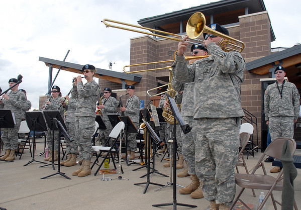 The Colorado National Guard 101st Army Band stands while they play a song during the Broomfield Veterans Memorial Museum Memorial Day Picnic at the Broomfield County Commons Park on Monday.<br /> May 30, 2011<br /> staff photo/David R. Jennings
