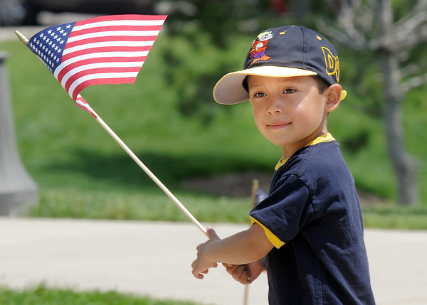 Luke Wangsvick, 4, carries a flag given to him by the Broomfield Police Honor Guard during the Broomfield Veterans Memorial Museum Memorial Day Picnic at the Broomfield County Commons Park on Monday.<br /> May 30, 2011<br /> staff photo/David R. Jennings
