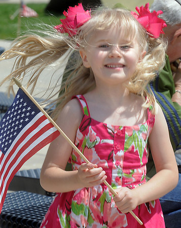 Lauren Johnson, 5 1/2, from Scottsbluff, Nebraska, carries a flag during the Broomfield Veterans Memorial Museum Memorial Day Picnic at the Broomfield County Commons Park on Monday. <br /> May 30, 2011<br /> staff photo/David R. Jennings