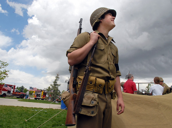 """Jarred Schroeder, 15, with """"Crew 42"""" re-enactment group and Boy Scout Troop 49 out of Lafayette, looks at the clouds forming as he stands guard next to tents during the Broomfield Veterans Memorial Museum Memorial Day Picnic at the Broomfield County Commons Park on Monday.<br /> May 30, 2011<br /> staff photo/David R. Jennings"""