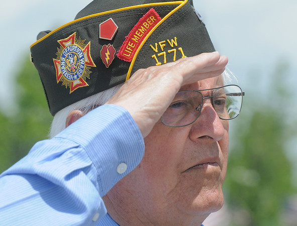 Dave Ortega, a korean War veteran from Lafayette, salute during the playing of the national anthem at the Broomfield Veterans Memorial Museum Memorial Day Picnic at the Broomfield County Commons Park on Monday.<br /> May 30, 2011<br /> staff photo/David R. Jennings
