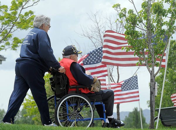 World War II veteran Paul Murphy, a survivor of the sinking of the U.S.S. Indianapolis, is pushed by his wife, Mary Lou, after the Broomfield Veterans Memorial Museum Memorial Day Picnic at the Broomfield County Commons Park on Monday.<br /> May 30, 2011<br /> staff photo/David R. Jennings