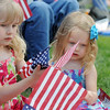 Lauren Johnson, 5 1/2, left, and her sister Lyndsay, 3, from Scottsbluff, Nebraska, look at flags while their father plays in the Colorado National Guard 101st Army Band during the Broomfield Veterans Memorial Museum Memorial Day Picnic at the Broomfield County Commons Park on Monday. <br /> May 30, 2011<br /> staff photo/David R. Jennings