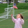Morgan Beltzer, 4, looks a her flag during the Broomfield Veterans Memorial Museum Memorial Day Picnic at the Broomfield County Commons Park on Monday.<br /> May 30, 2011<br /> staff photo/David R. Jennings