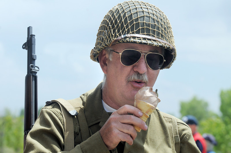 Lew Ludwig with Crew 42 re-enactment group eats an ice cream cone  during the Broomfield Veterans Memorial Museum Memorial Day Picnic at the Broomfield County Commons Park on Monday.<br /> May 30, 2011<br /> staff photo/David R. Jennings