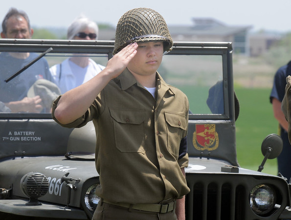 Jarred Schroeder, 15, with the Crew 42 re-enactment group and Boy Scout Troop 49 Lafayette, salutes during the national anthem while standing in front of a World War II Army Jeep at the Broomfield Veterans Memorial Museum Memorial Day Picnic at the Broomfield County Commons Park on Monday.<br /> May 30, 2011<br /> staff photo/David R. Jennings