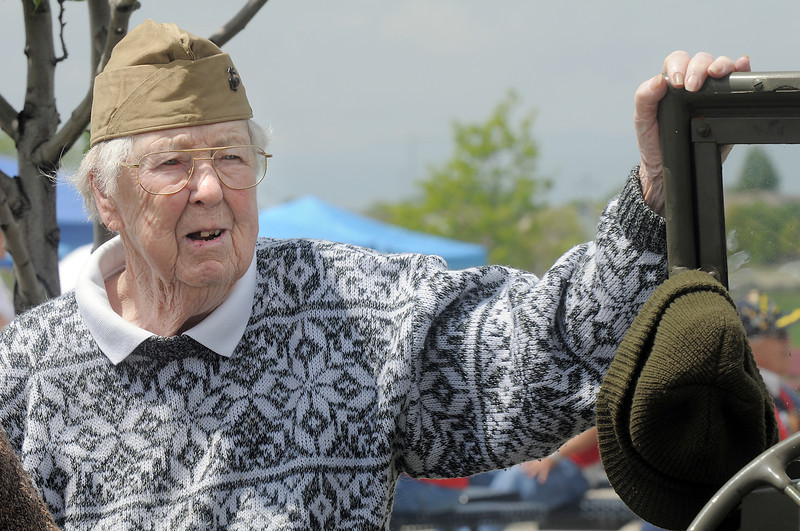 """Irene """"Irish"""" Brophy a World War II veteran and U.S. Marine, looks at a WWII Jeep on display at the Broomfield Veterans Memorial Museum Memorial Day Picnic at the Broomfield County Commons Park on Monday.<br /> May 30, 2011<br /> staff photo/David R. Jennings"""