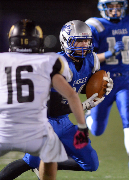 Broomfield's Luke McAninch runs a kickoff return against Monarch's Geoff Clary during Friday's game at Elizabeth Kennedy Stadium.<br /> October 25, 2012<br /> staff photo/ David R. Jennings