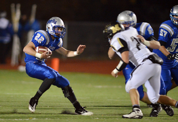 Broomfield's  Ryan McCulley turns while running downfield against Monarch during Friday's game at Elizabeth Kennedy Stadium.<br /> October 25, 2012<br /> staff photo/ David R. Jennings