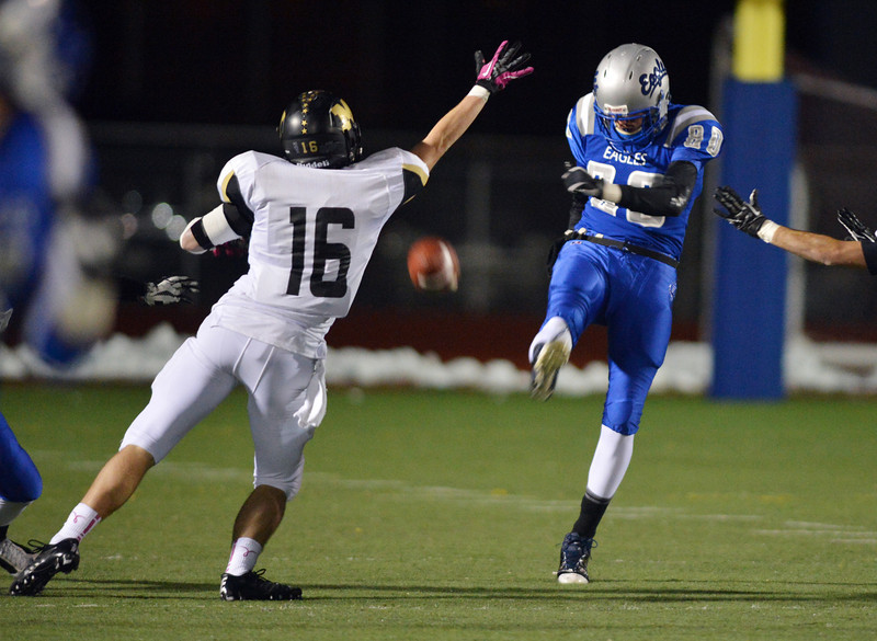 Broomfield's Spencer Reed's punt is knocked to the side by Monarch's Geoff Clary during Friday's game at Elizabeth Kennedy Stadium.<br /> October 25, 2012<br /> staff photo/ David R. Jennings