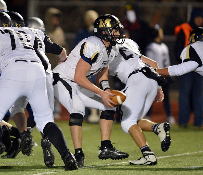 Monarch's quarterback Cole Watson prepares to handoff for a run against Broomfield during Friday's game at Elizabeth Kennedy Stadium.<br /> October 25, 2012<br /> staff photo/ David R. Jennings