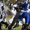 Monarch's Ethan Marks carries the ball through the Broomfield line during Friday's game at Elizabeth Kennedy Stadium.<br /> October 25, 2012<br /> staff photo/ David R. Jennings