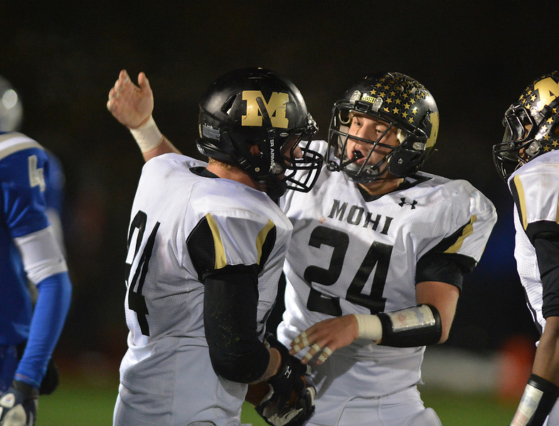 Monarch's Colin Hart, center congratulates Casey Sloan after a play against Broomfield during Friday's game at Elizabeth Kennedy Stadium.<br /> October 25, 2012<br /> staff photo/ David R. Jennings