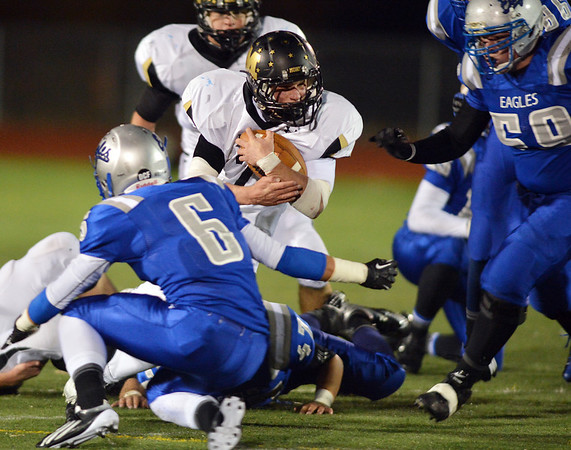 Monarch's Ethan Marks runs the ball downfield as Broomfield's Gian Panicucci tries to make the tackle during Friday's game at Elizabeth Kennedy Stadium.<br /> October 25, 2012<br /> staff photo/ David R. Jennings