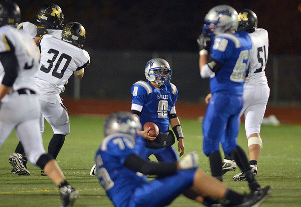 Broomfield's quarterback Angelo Perez kneels with the ball after being sacked by Monarch during Friday's game at Elizabeth Kennedy Stadium.<br /> October 25, 2012<br /> staff photo/ David R. Jennings