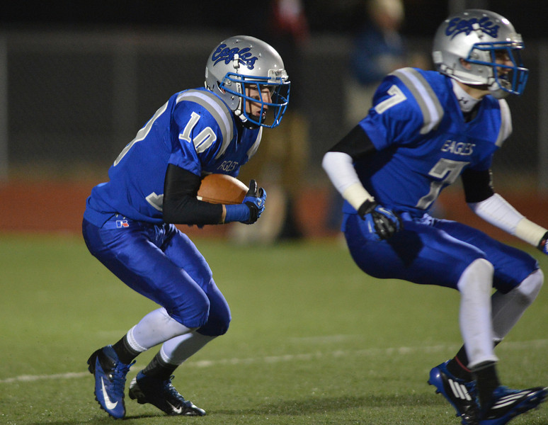Broomfield's Dylan Plane runs the ball downfield against Monarch during Friday's game at Elizabeth Kennedy Stadium.<br /> October 25, 2012<br /> staff photo/ David R. Jennings