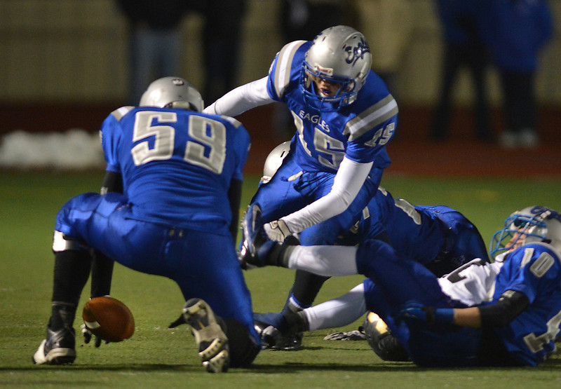 Broomfield's Blake Whitsell recover a Monarch fumble during Friday's game at Elizabeth Kennedy Stadium.<br /> October 25, 2012<br /> staff photo/ David R. Jennings