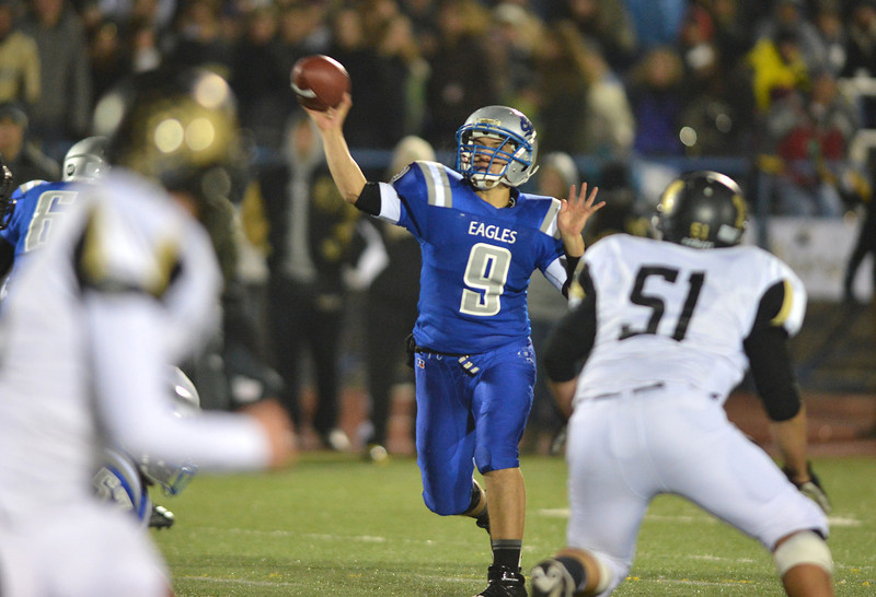 Broomfield's quarterback Angelo Perez passes over Monarch during Friday's game at Elizabeth Kennedy Stadium.<br /> October 25, 2012<br /> staff photo/ David R. Jennings