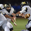 Monarch's  quarterback Cole Watson hands off the ball for a run against Broomfield during Friday's game at Elizabeth Kennedy Stadium.<br /> October 25, 2012<br /> staff photo/ David R. Jennings
