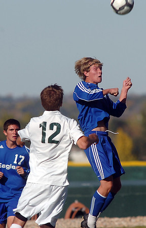 Thomas O'Brien, Broomfield, does a header past Tommy Hoffman, Niwot during  Thursday's game at Niwot.<br /> October 20, 2011<br /> staff photo/ David R. Jennings