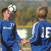 Broomfield's Davis DeGregorio does a header with back-up from Thomas O'Brien  against Niwot during Thursday's game at Niwot.<br /> October 20, 2011<br /> staff photo/ David R. Jennings