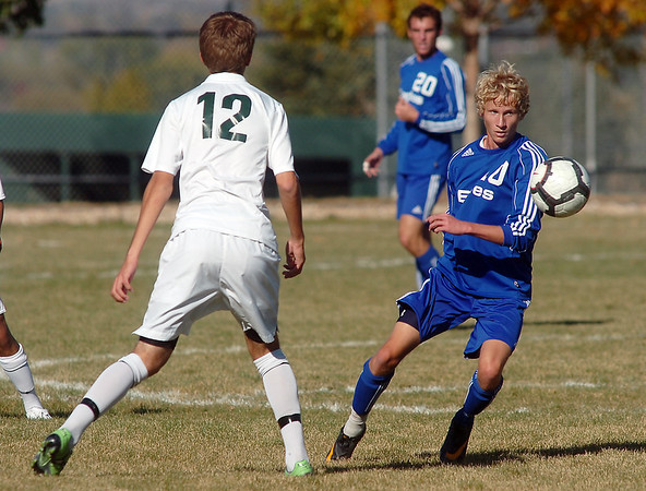 Tim Ayers, Broomfield, moves the ball past Tommy Hoffman, Niwot during  Thursday's game at Niwot.<br /> October 20, 2011<br /> staff photo/ David R. Jennings