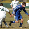 Connor Metzger, Broomfield moves the ball away from Jesus Olivas,  Niwot during  Thursday's game at Niwot.<br /> October 20, 2011<br /> staff photo/ David R. Jennings
