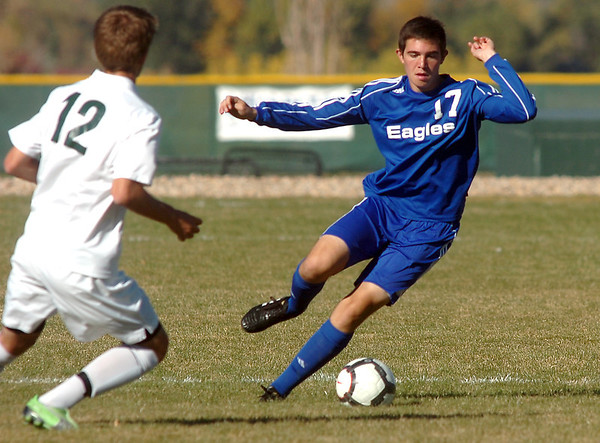 Davis DiGregorio,  Broomfield moves the ball away from Tommy Hoffman, Niwot during  Thursday's game at Niwot.<br /> October 20, 2011<br /> staff photo/ David R. Jennings