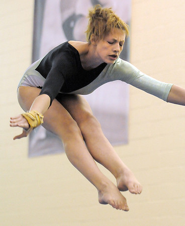 Niwot's Allie Koldeway performs on the beam during competition at the Paul Derda Recreation Center in Broomfield on Tuesday.<br /> September 13, 2011<br /> staff photo/ David R. Jennings